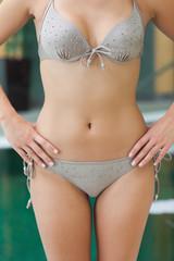 Woman in grey bikini