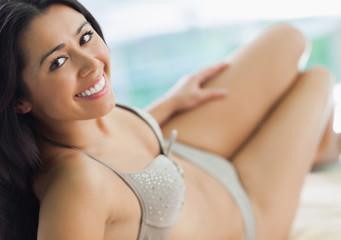 Pretty woman wearing grey bikini