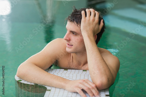 Man relaxing in swimming pool