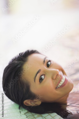 Pretty smiling woman lying in a jacuzzi