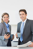 Business couple having coffee before work