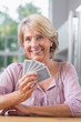 Smiling woman playing cards