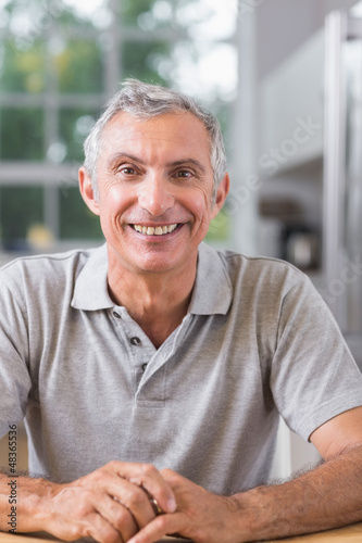 Smiling man looking at camera