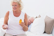 Aged woman with the opened pill bottle
