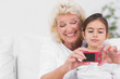 Granddaughter and grandmother taking pictures