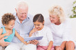 Grandparents with children using a tablet pc