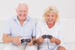 Aged couple playing video games