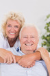 Cheerful old couple portrait hugging