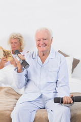Old man lifting hand weights