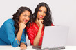 Cute smiling female students on laptop