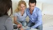 Couple signing property contract with real-estate agent