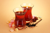 glasses of Turkish tea and rahat Delight, on beige background
