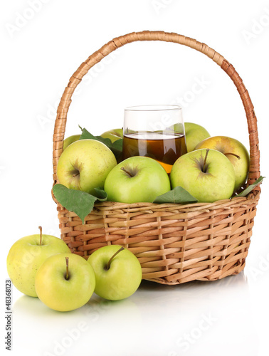 Useful apple juice with apples around in basket isolated