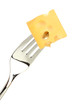 Cheese cube on fork isolated on white