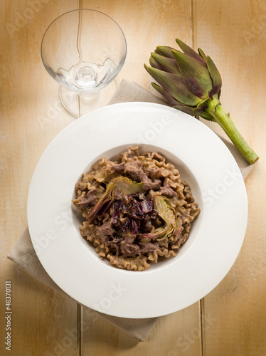 integral pasta with artichoke and chicory, vegetarian food
