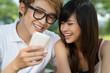 Teens with gadget