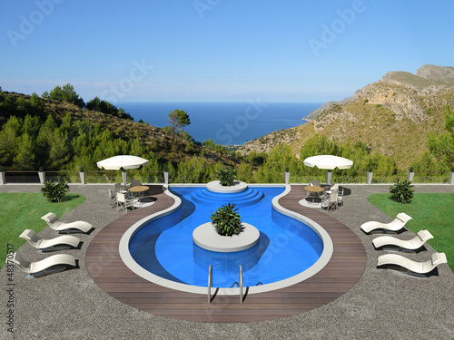 a terrace with swimming pool and beautiful view to the sea
