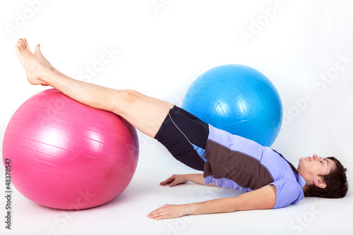 Sporty woman doing exercise with gym ball