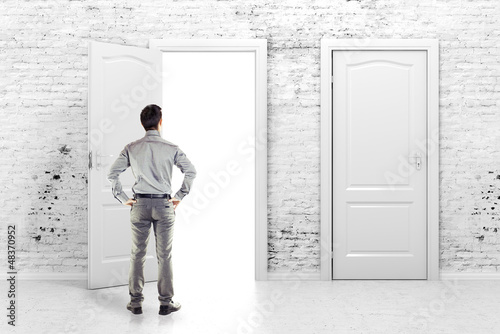 young business man in front of an open door