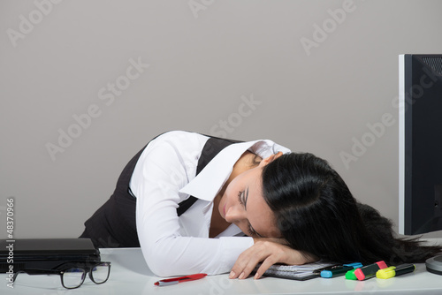 Young woman sleeping on her workplace