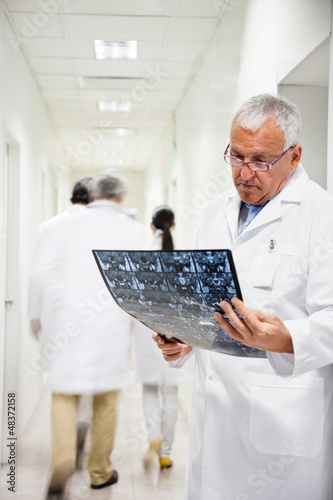 Senior Radiologist Reviewing X-ray