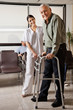 Female Nurse Helping Senior Patient With Walker