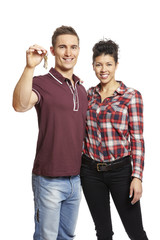 Young couple holding set of house keys