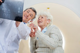 Doctor With Patient Looking At MRI X-ray