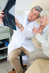 Radiologist Explaining X-ray To Patient