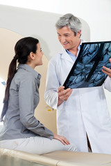 Radiologist Looking At Female Patient