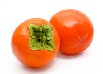 Two orange ripe persimmon isolated