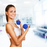 Dumbbell bicep curl by a fitness girl