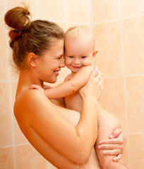 Mother and baby daughter in the shower