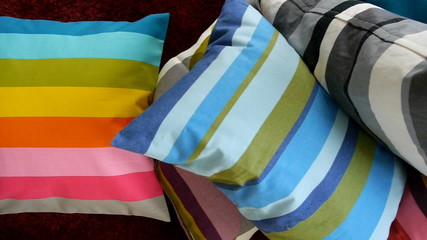 Pile of colorful scatter cushions.
