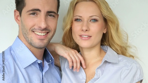 Cheerful couple talking to camera