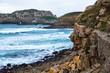 An orange cliff near the blue sea