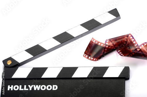 Movie clapper board and film strip