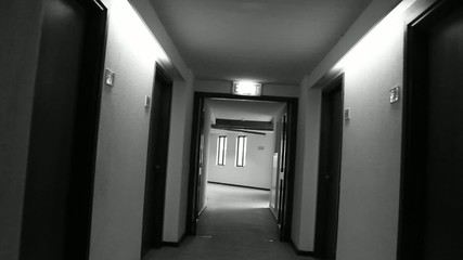 Walking down a hotel hallway