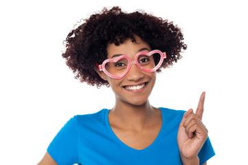 Pretty woman wearing funny heart shaped frame
