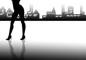 silhouette gambe di donna con città di sfondo