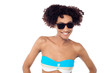 Smiling curly haired bikini model in dark shades