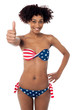 United States flag bikini model gesturing thumbs up