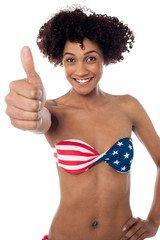 Stars and stripes bikini model showing thumbs up
