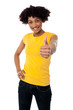 Happy smiling lady showing thumbs up gesture