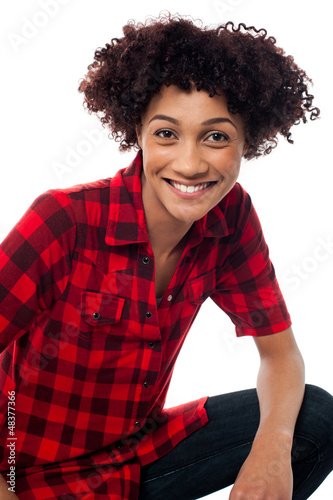 Portrait of smiling woman, semi seated posture