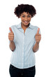 Excited woman gesturing double thumbs up