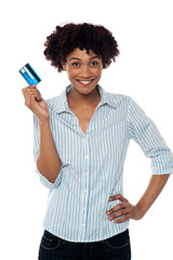 Cheerful lady in casuals holding up cash card