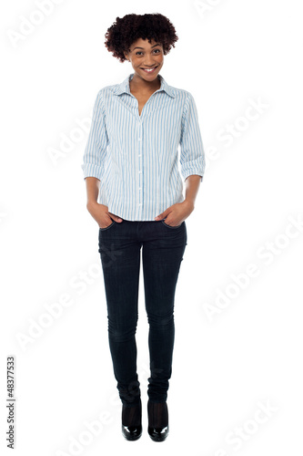 Trendy woman with curly hair dressed in casuals