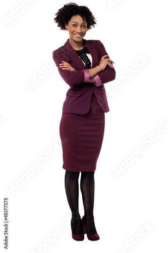 Confident corporate woman with folded arms