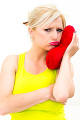 sad woman holding red valentine heart